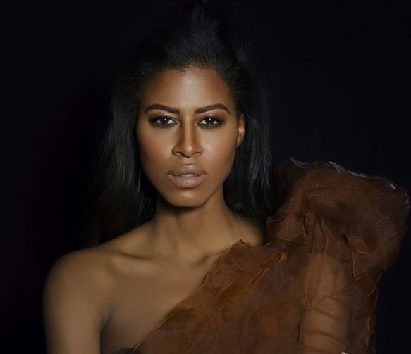 model in brown dress
